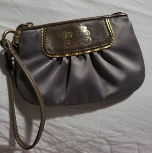 COACH WRISTLET IN GRAY SATIN MATERIAL!